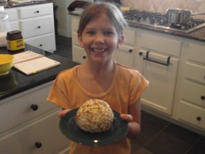 Vivian's first Cheeseball. She chose slivered almonds for the outer coating. Already improving on family classics like a pro.